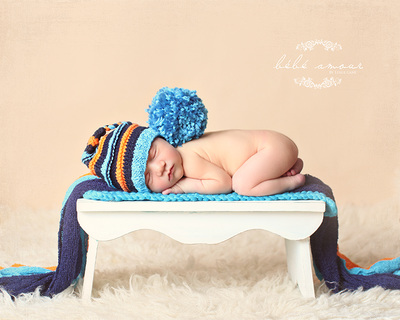 baby boy striped blanket and orange hat