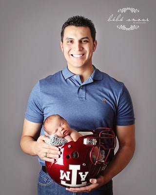 football player with newborn in helmet